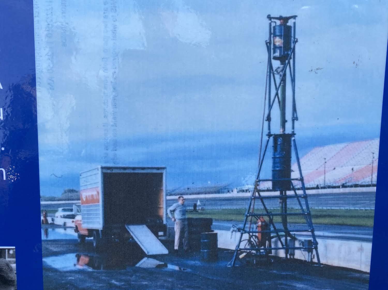 vintage racing gas pump tower setup at race track