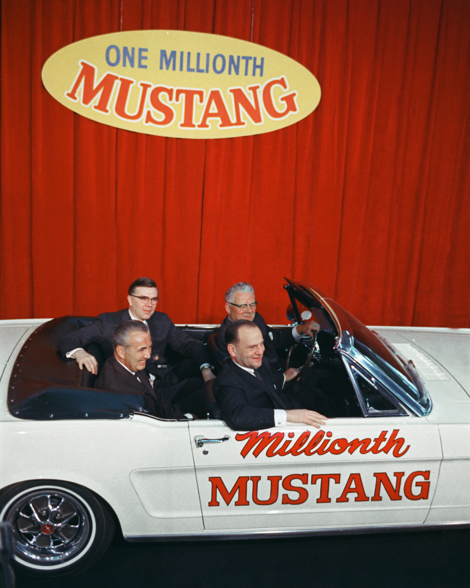 executives ride in ford convertible as millionth mustang