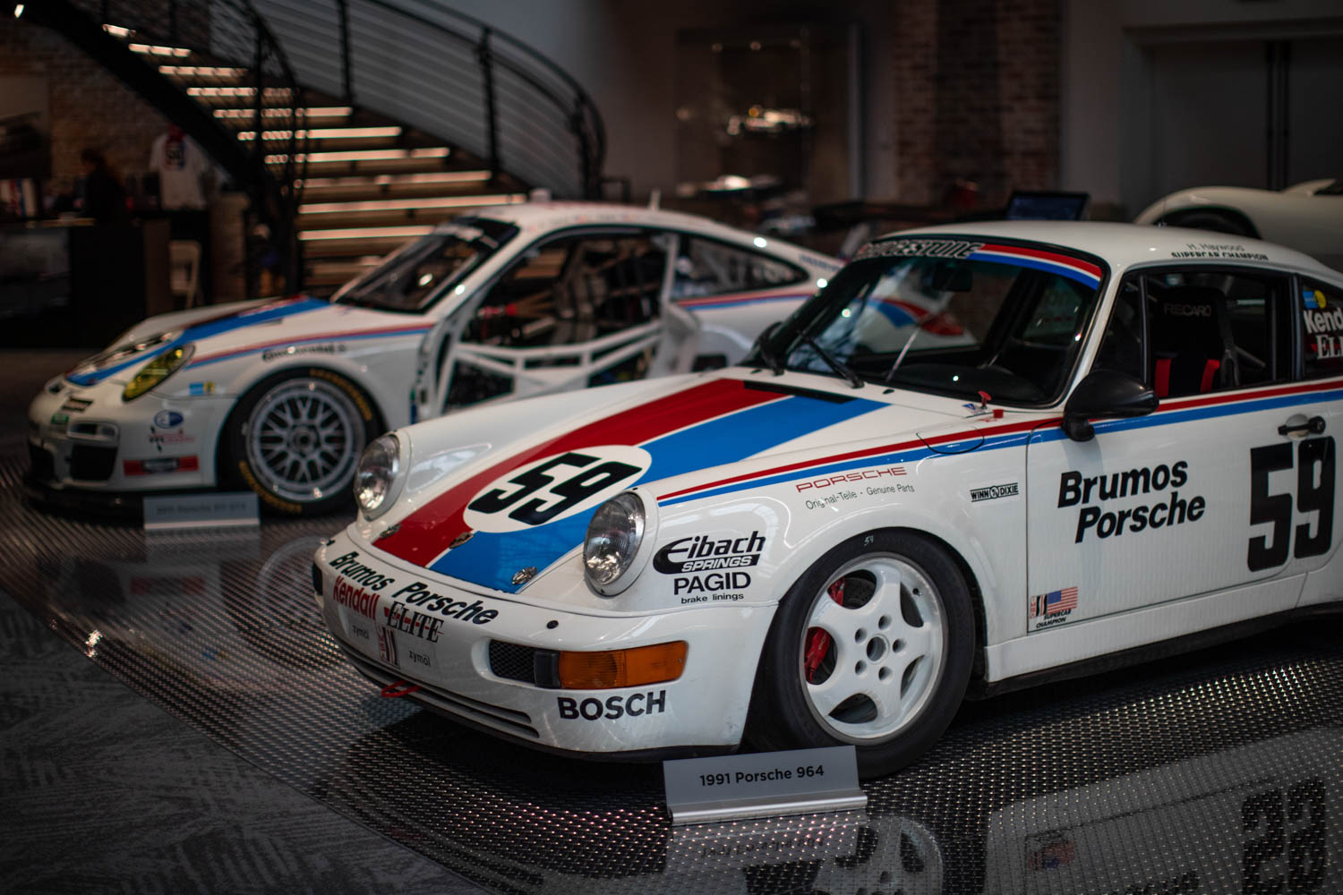The Brumos Porsches ran with red and blue stripes and the number 59, an ode to the U.S.S. Forrestal, CV-59.