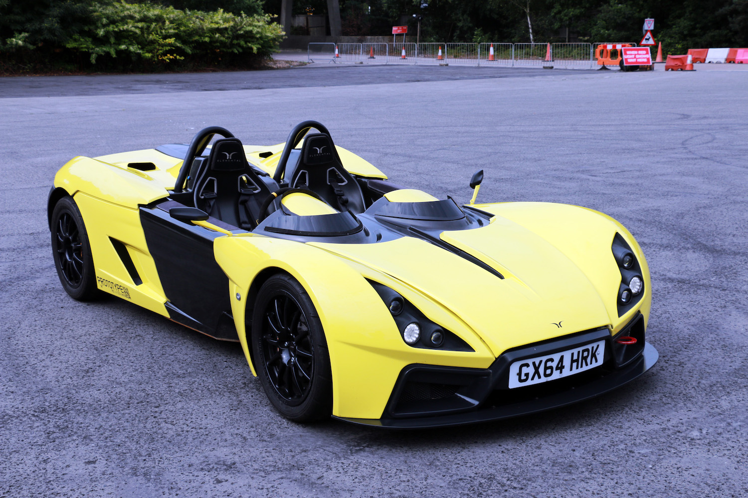 yellow roadster prototype front three-quarter