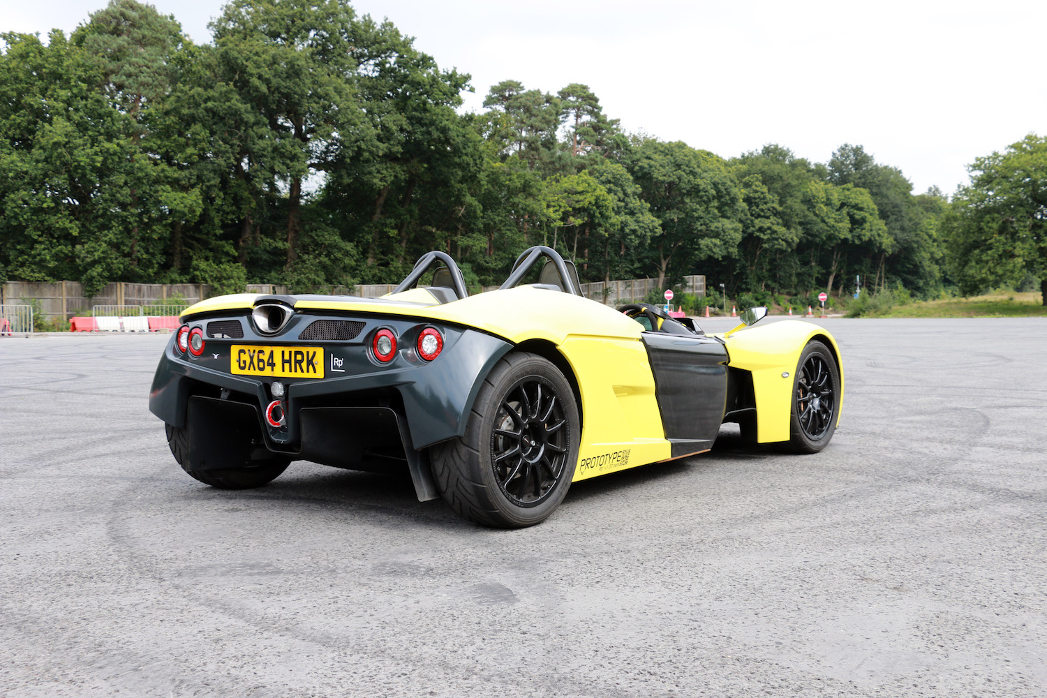 yellow prototype roadster front three-quarter