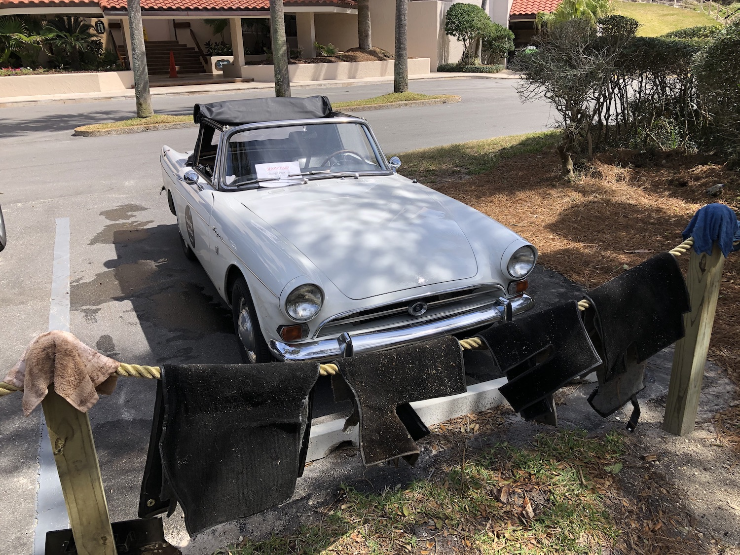 white sunbeam tiger front three-quarter with floor mats on line drying