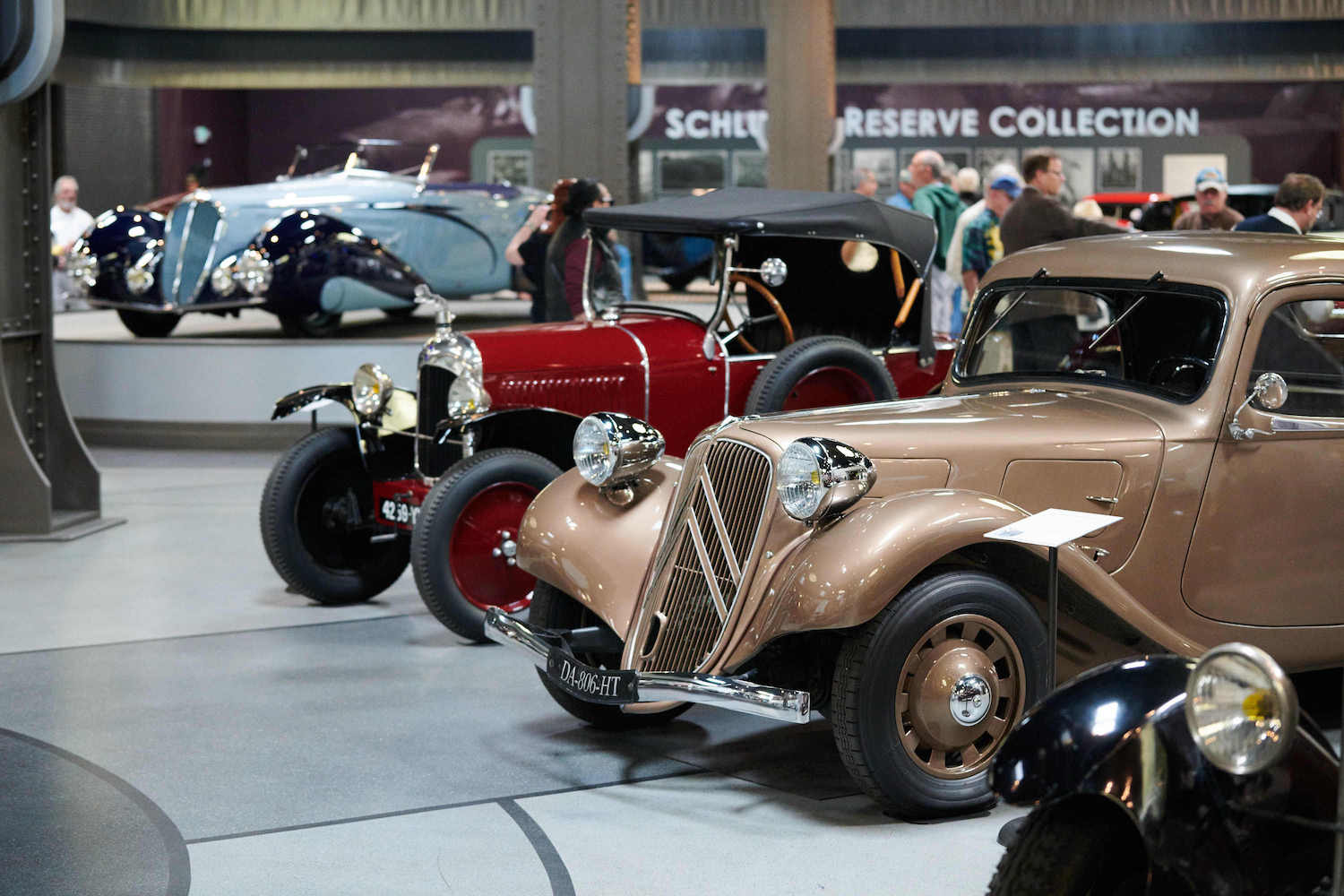 vintage cars on museum display floor