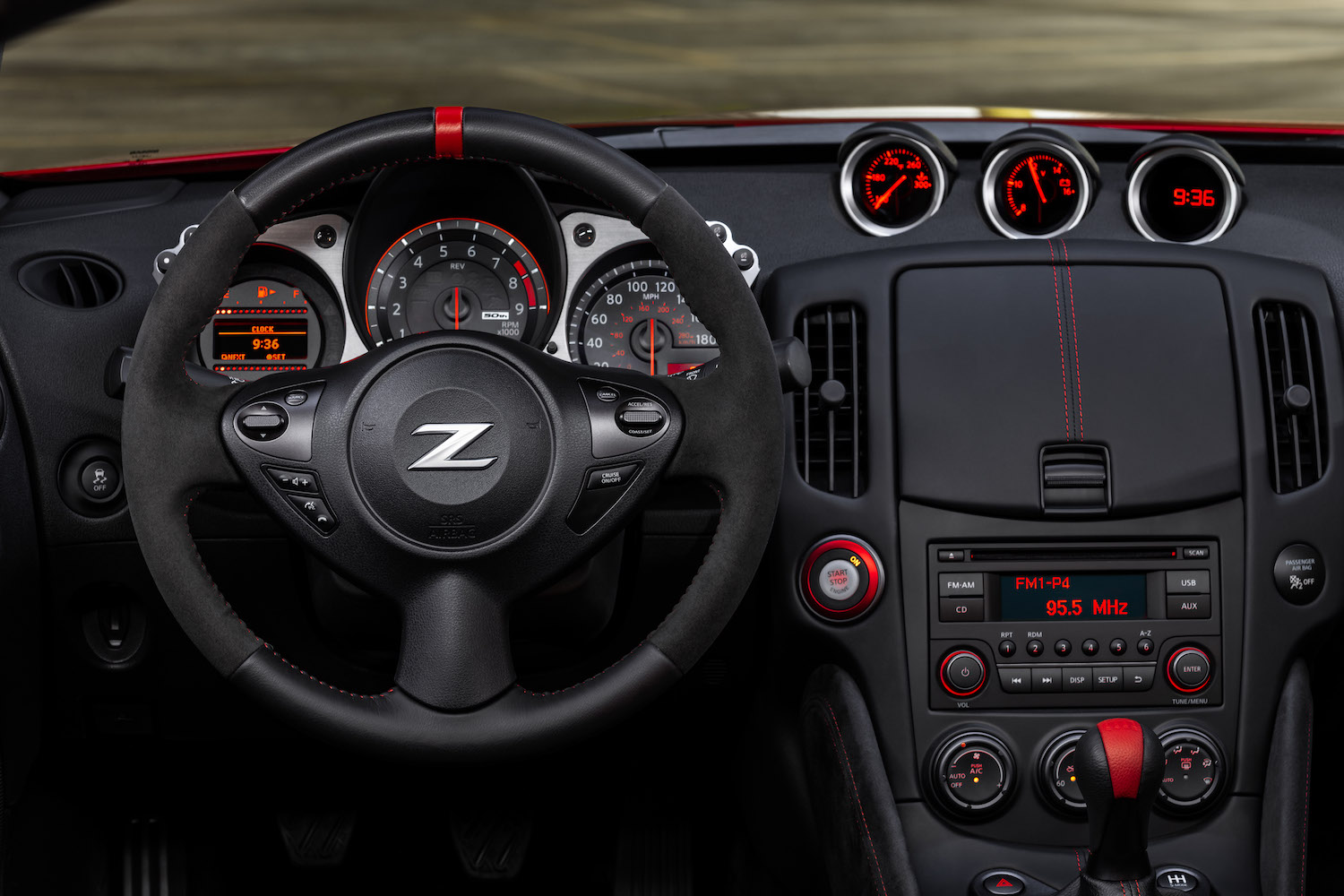 nissan z logo on steering wheel of car interior front
