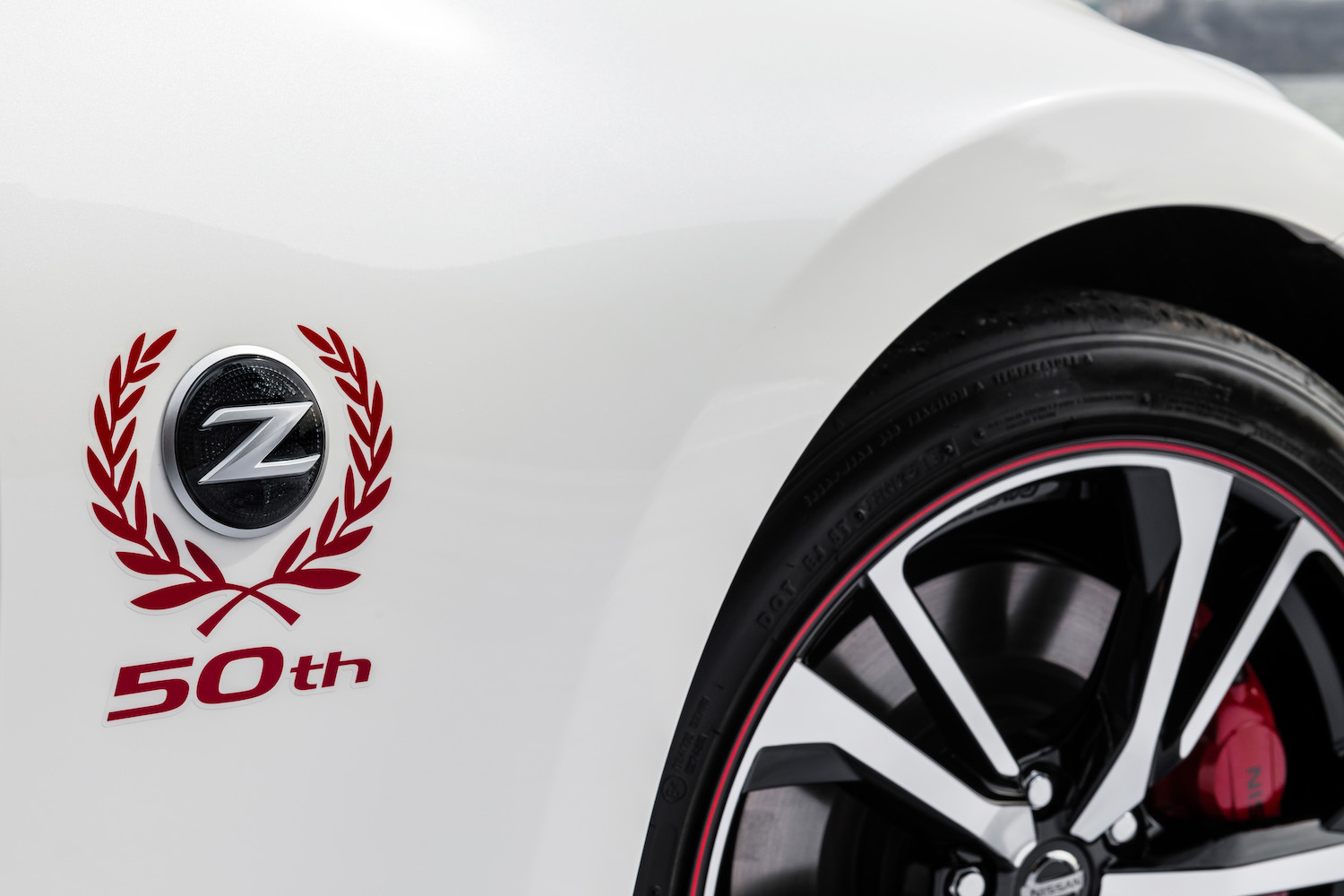 nissan z 50th anniversary logo badge on front quarter panel