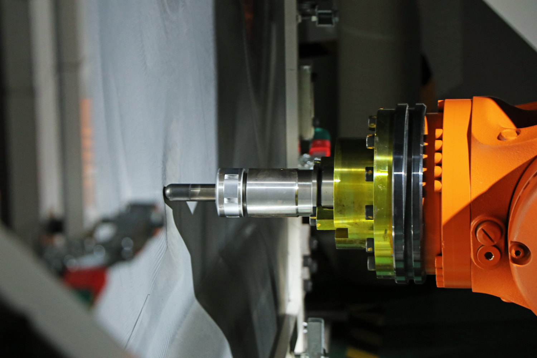 robot stamping steel closeup