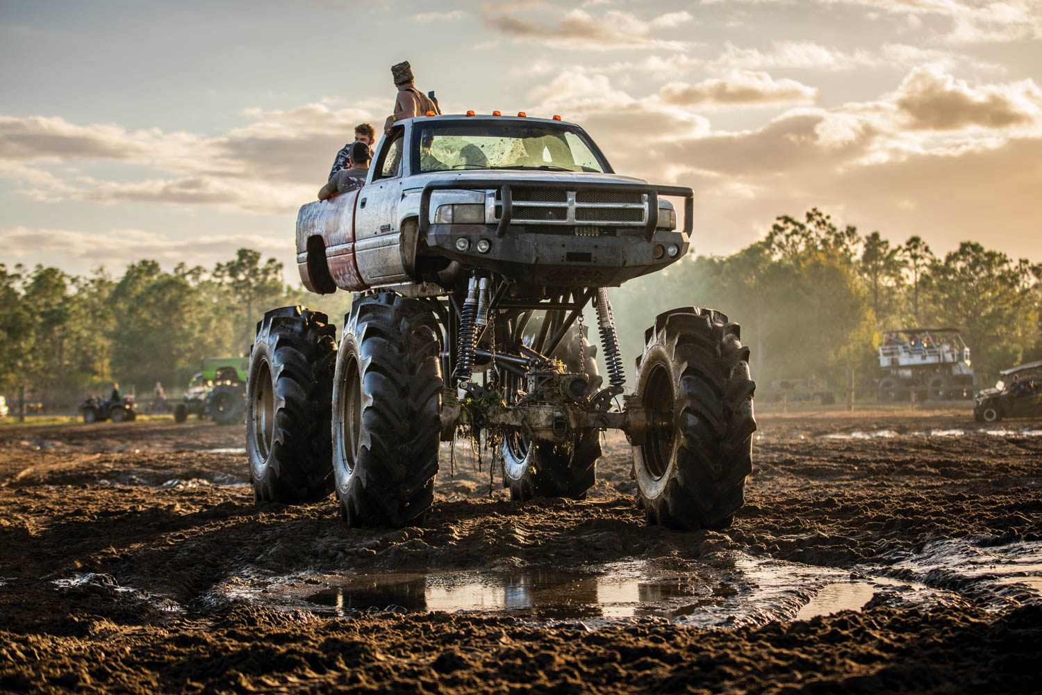 Homemade monster trucks like this hulking Ram, their big beds filled with beer and bros, are staples at the Mud Park.