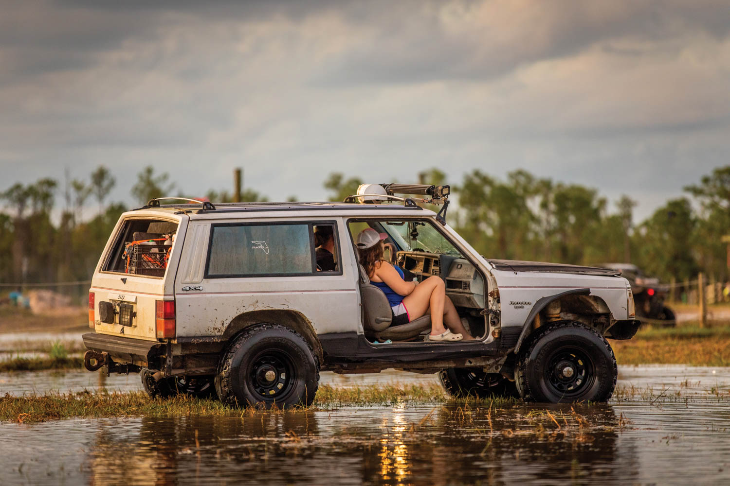 The Jeep Cherokee XJ-generation is right at home in the Florida mud pits. Doors optional.