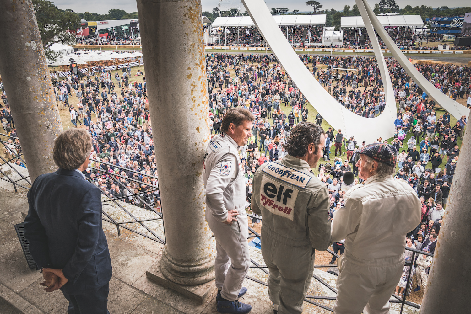 race car drivers at megaphone in front of goodwood festival of speed crowd