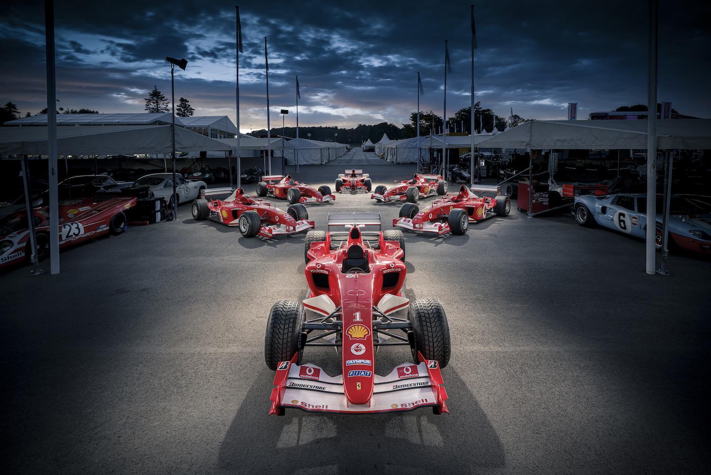 ferrari formula one cars in paddock area goodwood