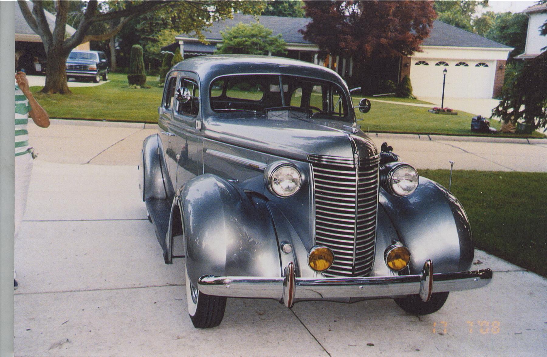restored 1938 nash sedan front three-quarter in driveway