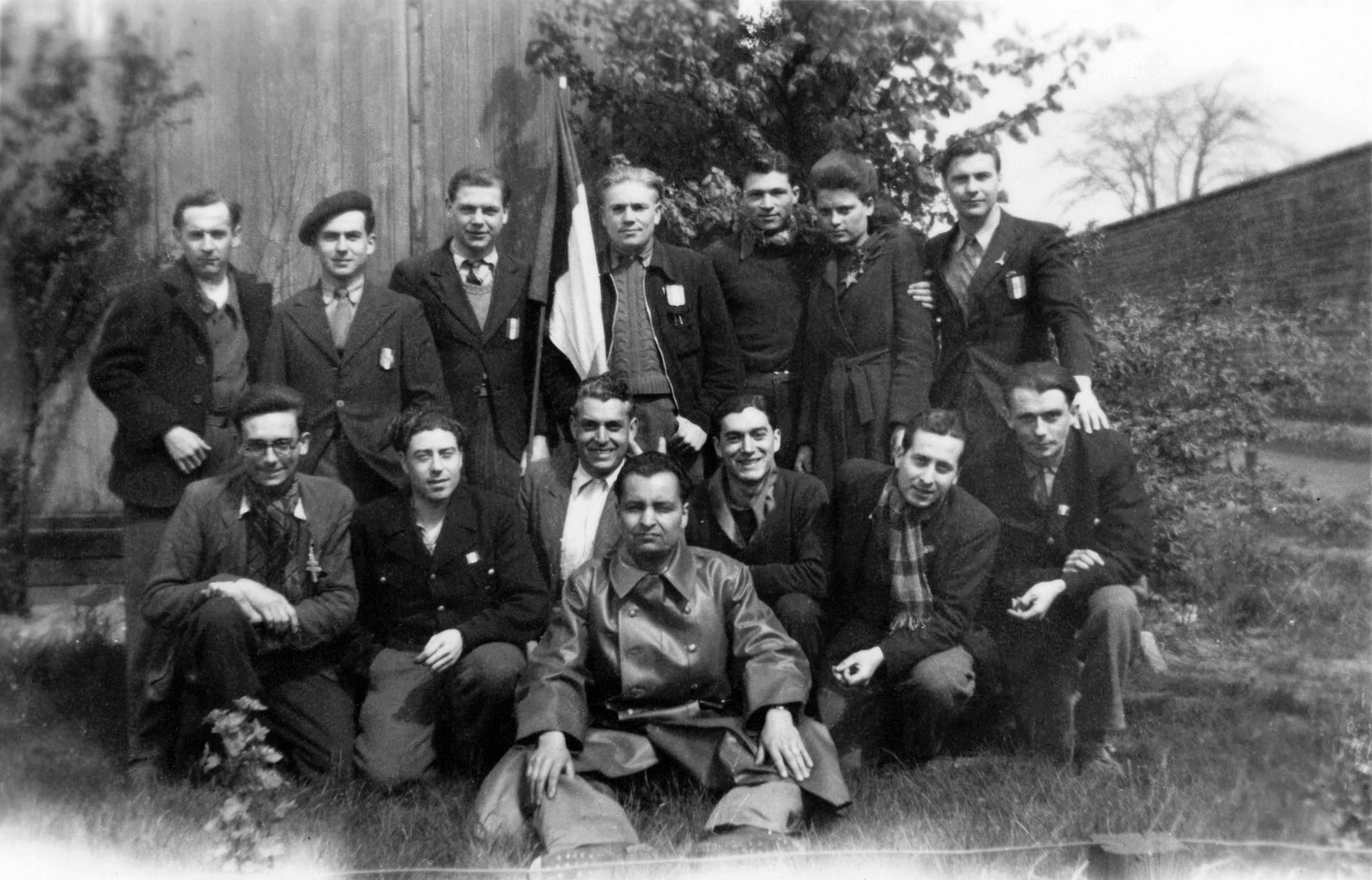 French forced laborers with tricolor following their liberation.