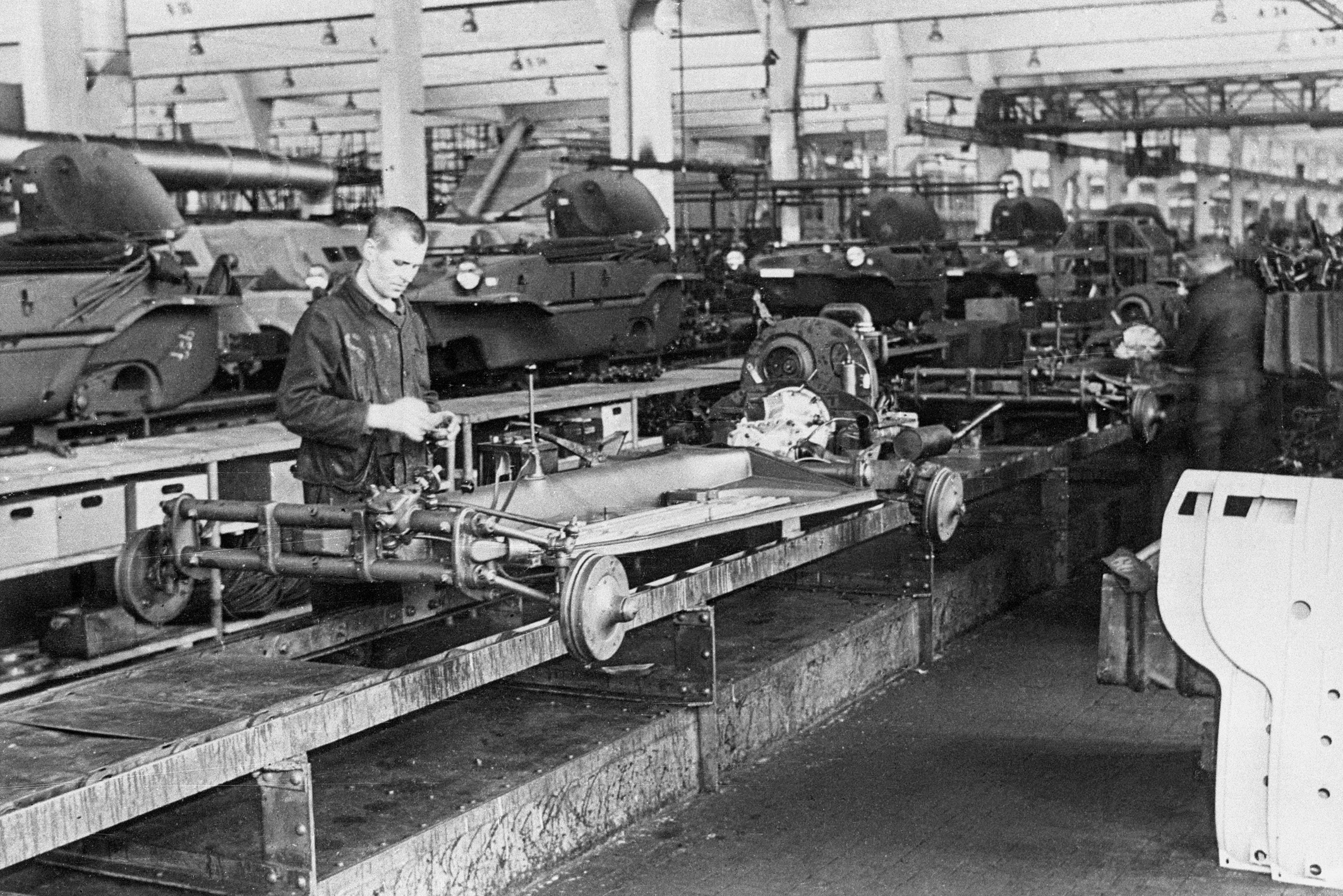 Soviet forced laborers on the Schwimmwagen assembly line during World War II.